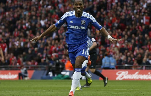 Chelsea's Didier Drogba (L) celebrates after scoring against Liverpool during their FA Cup final soccer match at Wembley Stadium in London, May 5, 2012. Reuters/Eddie Keogh (BRITAIN - Tags: SPORT SOCCER)