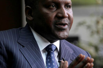 Founder and Chief Executive of the Dangote Group Aliko Dangote gestures during an interview with Reuters in his office in Lagos, Nigeria, June 13, 2012. To match Insight NIGERIA-FOREX/DANGOTE     REUTERS/Akintunde Akinleye/File Photo   - RTX2HPTG
