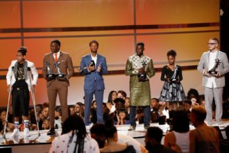 """2018 BET Awards - Show  - Los Angeles, California, U.S., 24/06/2018 - John Legend (not pictured) introduces six people for """"Hero's Row,"""" (from R) James Shaw Jr., Naomi Wadler, Mamoudou Gassama, Justin Blackman, Shaun King and Anthony Borges. REUTERS/Mario Anzuoni"""