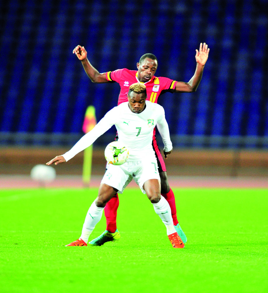 Mel William Togui of Ivory Coast challenged by Musitafa Mujuzi of Uganda during the 2018 CHAN football game between Uganda and Ivory Coast at the Grand stade Marrakech in Marrakech, Morocco on 22 January 2017 ©Samuel Shivambu/BackpagePix