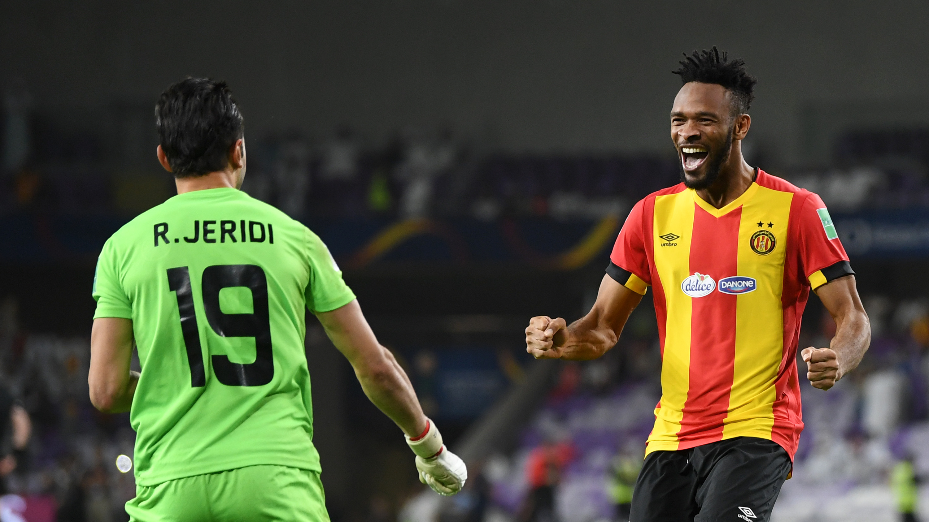 AL AIN, UNITED ARAB EMIRATES - DECEMBER 18: Rami Jeridi and Fousseny Coulibaly of ES Tunis celebrate victory following the penalty shoot out during the FIFA Club World Cup UAE 2018 5th Place Match between ES Tunis and CD Guadalajara at Hazza Bin Zayed Stadium on December 18, 2018 in Al Ain, United Arab Emirates. (Photo by David Ramos - FIFA/FIFA via Getty Images)