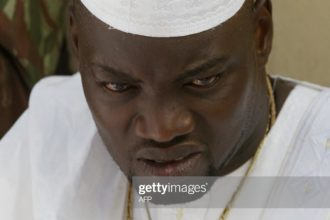 BOUAKE, IVORY COAST:  Wattao (L), one of the chief military commanders of the  New Force rebels, prays 14 November 2004 in Bouake, marking the end of the fasting month of Ramadan and the start of the Eid al-Fitr celebrations.        AFP PHOTO PHILIPPE DESMAZES  (Photo credit should read PHILIPPE DESMAZES/AFP via Getty Images)