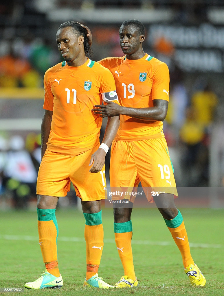 A dejected Didier Drogba of Ivory Coast is comforted by Yaya Toure after missing his penalty during the 2012 African Cup of Nations Final between Zambia and Ivory Coast at the Stade de l'Amitie in Libreville, Gabon. Photo: Ben Radford/Visionhaus (Photo by Ben Radford/Corbis via Getty Images)