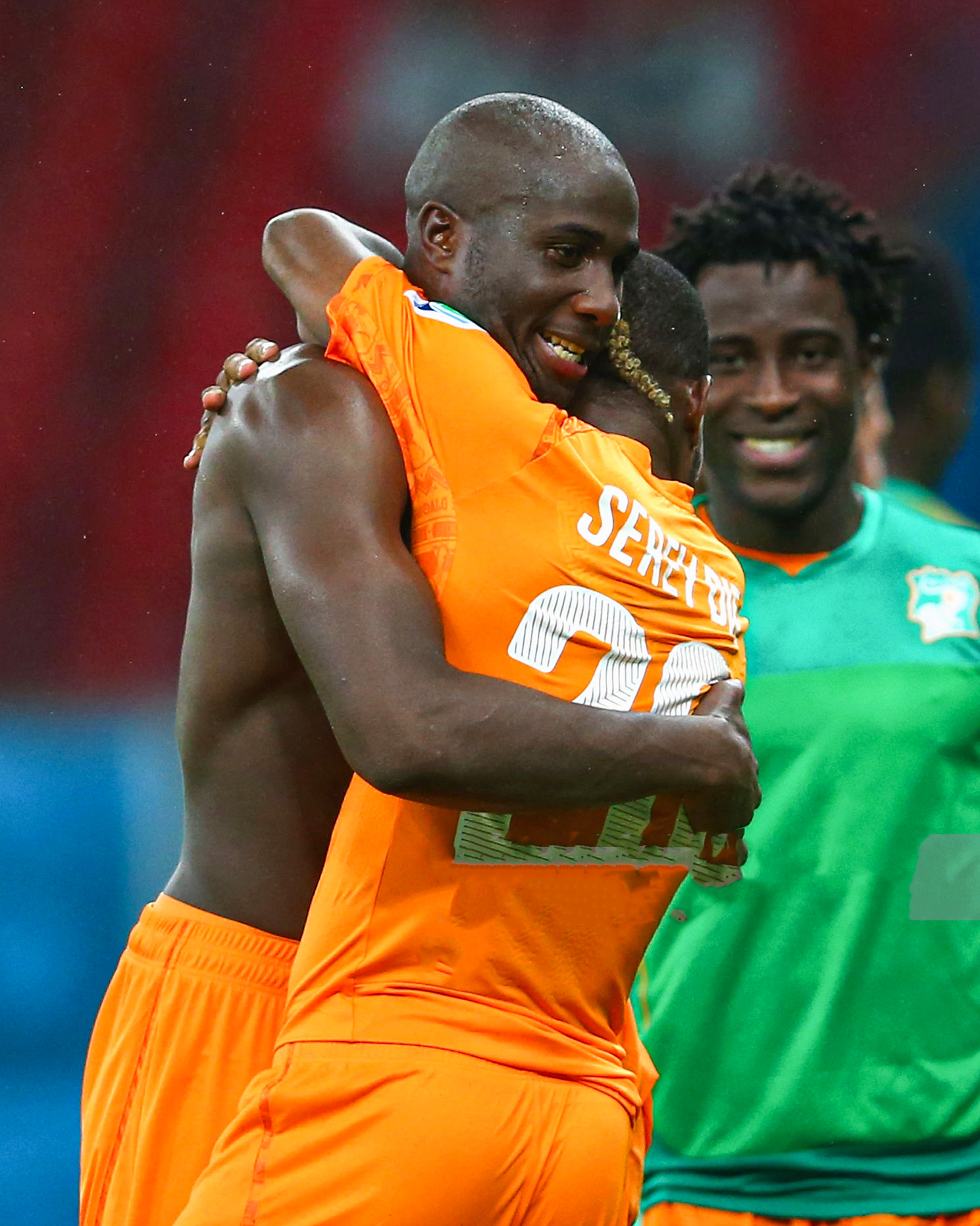 RECIFE, BRAZIL - JUNE 14: Sol Bamba of the Ivory Coast (L) hugs teammates Die Serey after defeating Japan 2-1 during the 2014 FIFA World Cup Brazil Group C match  between the Ivory Coast and Japan at Arena Pernambuco on June 14, 2014 in Recife, Brazil.  (Photo by Mark Kolbe/Getty Images)