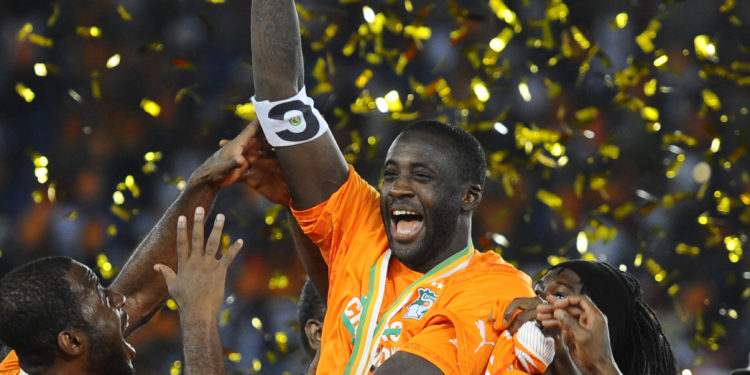 BATA, EQUATORIAL GUINEA - FEBRUARY 08: Ivory Coast's Yaya Toure (2nd L) holds up the trophy as he celebrates with his teammates after winning the 2015 African Cup of Nations final soccer match between Ivory Coast and Ghana at the Bata Stadium on February 08, 2015 in Bata, Equatorial Guinea. (Photo by Mohamed Hossam/Anadolu Agency/Getty Images)