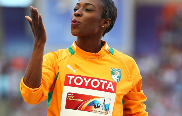 MOSCOW, RUSSIA - AUGUST 17:   Silver medalist Murielle Ahoure of Ivory Coast poses on the podium for the Women's 200 metres during Day Eight of the 14th IAAF World Athletics Championships Moscow 2013 at Luzhniki Stadium on August 17, 2013 in Moscow, Russia.  (Photo by Paul Gilham/Getty Images)